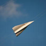 Paper aeroplane in blue sky